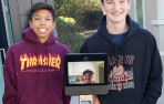 Middle school students with a telepresence robot named Sherlock