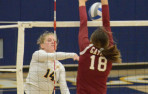 Menlo junior Emma Holland hits through the block against Sacred Heart Prep on Tuesday