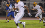 Menlo junior Jaden Richardson makes his way downfield against Santa Clara. Richardson finishing with a pair of TDs on defe...