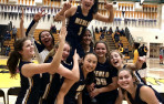 Menlo players hoist sophomore Avery Lee who sank the buzzer-beater for the win