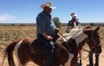 Greg Eaton '65 astride a horse while on a trip he took with multiple Menlo classmates in 2018.