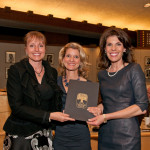 Menlo Park Mayor Catherine Carlton presents the proclamation to Centennial Co-Chairs Amy Sanford ...