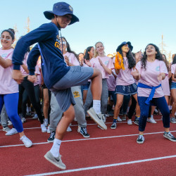Menlo School students parade during half time at the Homecoming game. Photo by Pete Zivkov.
