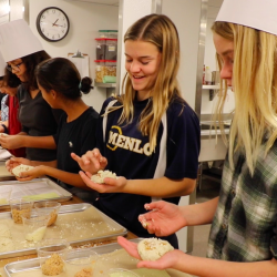Seventh grade Spanish students learn to roll and stuff pupusas in Menlo's new teaching kitchen.