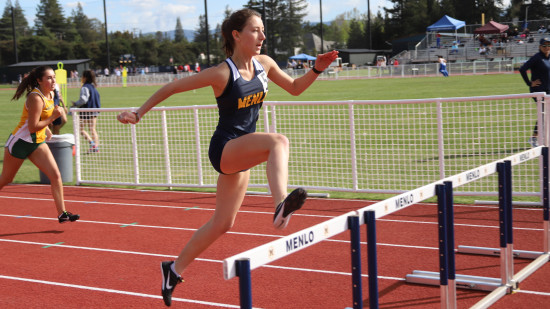 Runners compete on Senior Day 2019 at Menlo's newly-resurfaced track. Photo by Robert Tomkins...