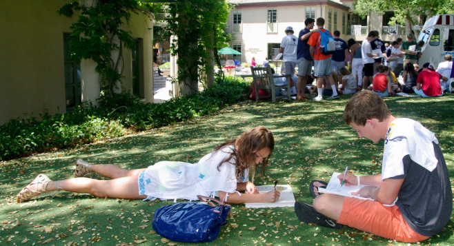 Menlo School students signing yearbooks during Day on the Green. Photo by Pete Zivkov.