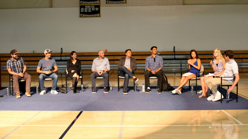 (Left to right) Chris Clark '93, Nick Woodman '93, Danielle Rees '95, Michael Schwab '94, Desi Banatao '94, and Rey Banatao '91 speak with student moderators during an assembly panel about action-sports careers