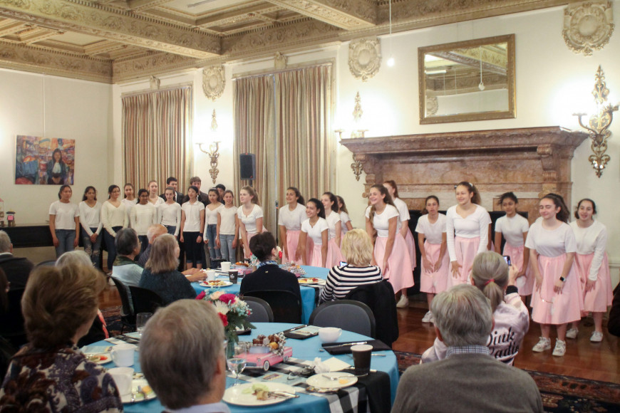 Students perform during a 50s themed grandparents event at Menlo